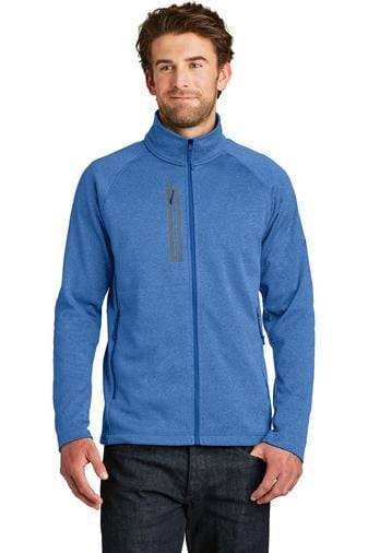 A front view of a man wearing men's The North Face Canyon Flats monster blue heather fleece jacket