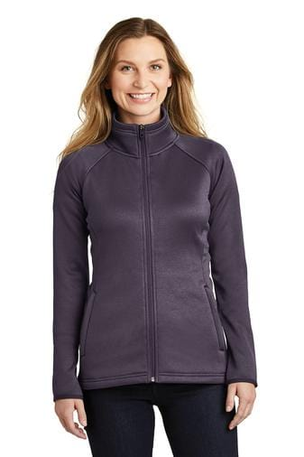 A front view of a woman wearing ladies The North Face Canyon Flats dark eggplant purple heather stretch fleece jacket