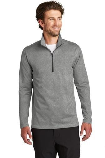 A front view of a man wearing men's The North Face tech 1/4 zip asphalt grey heather fleece jacket