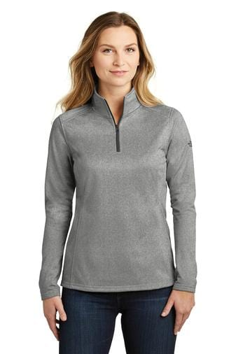A front view of a woman wearing ladies The North Face tech 1/4 zip asphalt grey heather fleece jacket