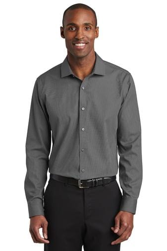 A front view of a man wearing men's Red House slim fit Nailhead non-iron black shirt