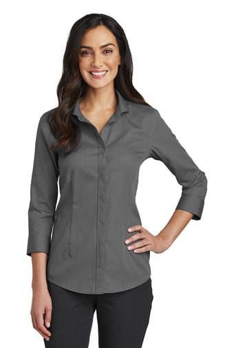 A front view of a woman wearing ladies Red House 3/4 sleeve Nailhead non-iron black shirt