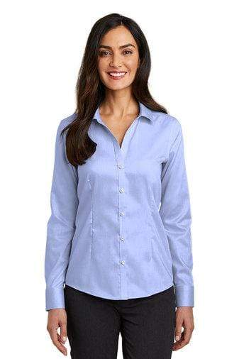 A front view of a woman wearing ladies Red House pinpoint oxford non-iron blue shirt