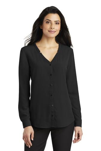 A front view of a woman wearing ladies Port Authority black long sleeve button front blouse