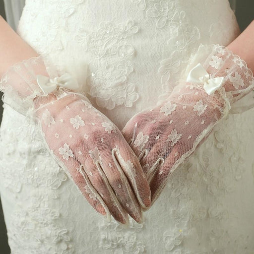 Elegant Lace Wrist Length With Bow Wedding Gloves | Bridelily - wedding gloves