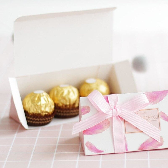 Feather Pink Chocolate With Ribbon Favor Holders | Bridelily - favor holders