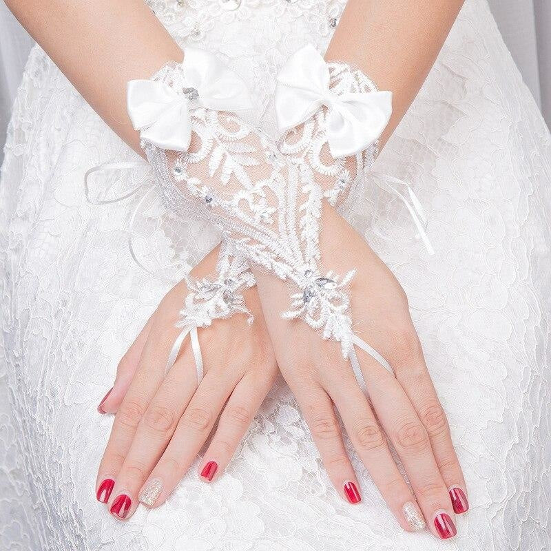 Fingerless Elegant Short White Lace Wedding Glove | Bridelily - wedding gloves