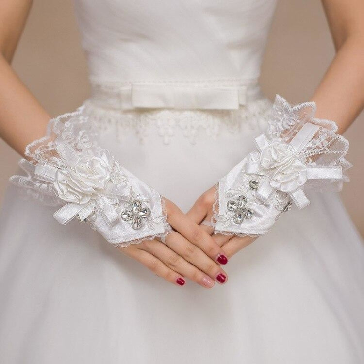 Lace Wrist Length Fingerless New Wedding Glove | Bridelily - wedding gloves