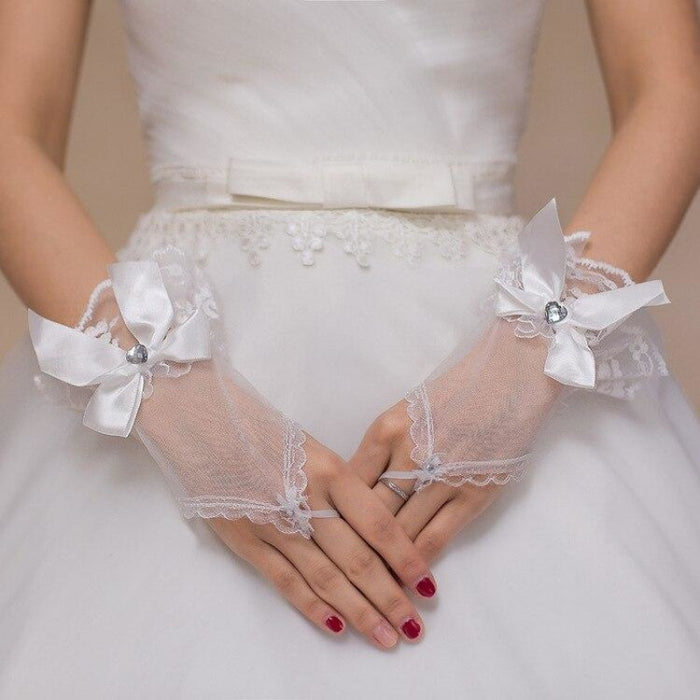 Tull bow Fingerless Wrist Length Wedding Gloves | Bridelily - wedding gloves