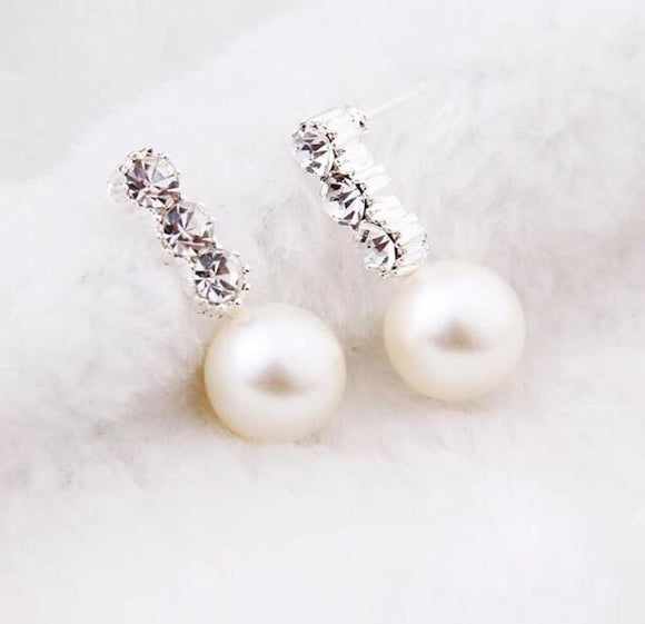 Three crystal pearl earrings