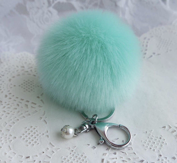 Teal pom pom with pearl bag charm