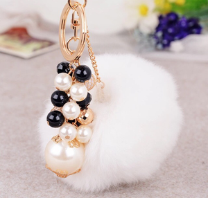 White bag charm with pearls