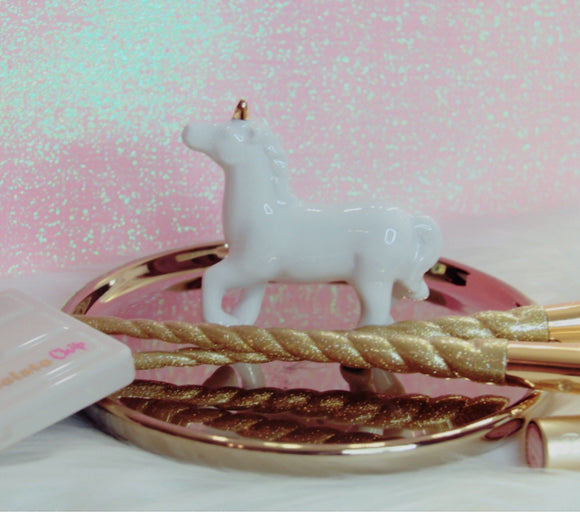 White unicorn on a gold tray