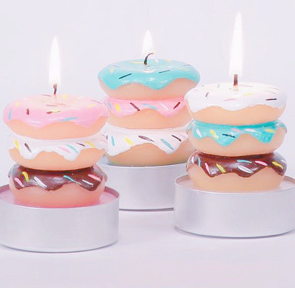 Three piece set of donut stacked candles