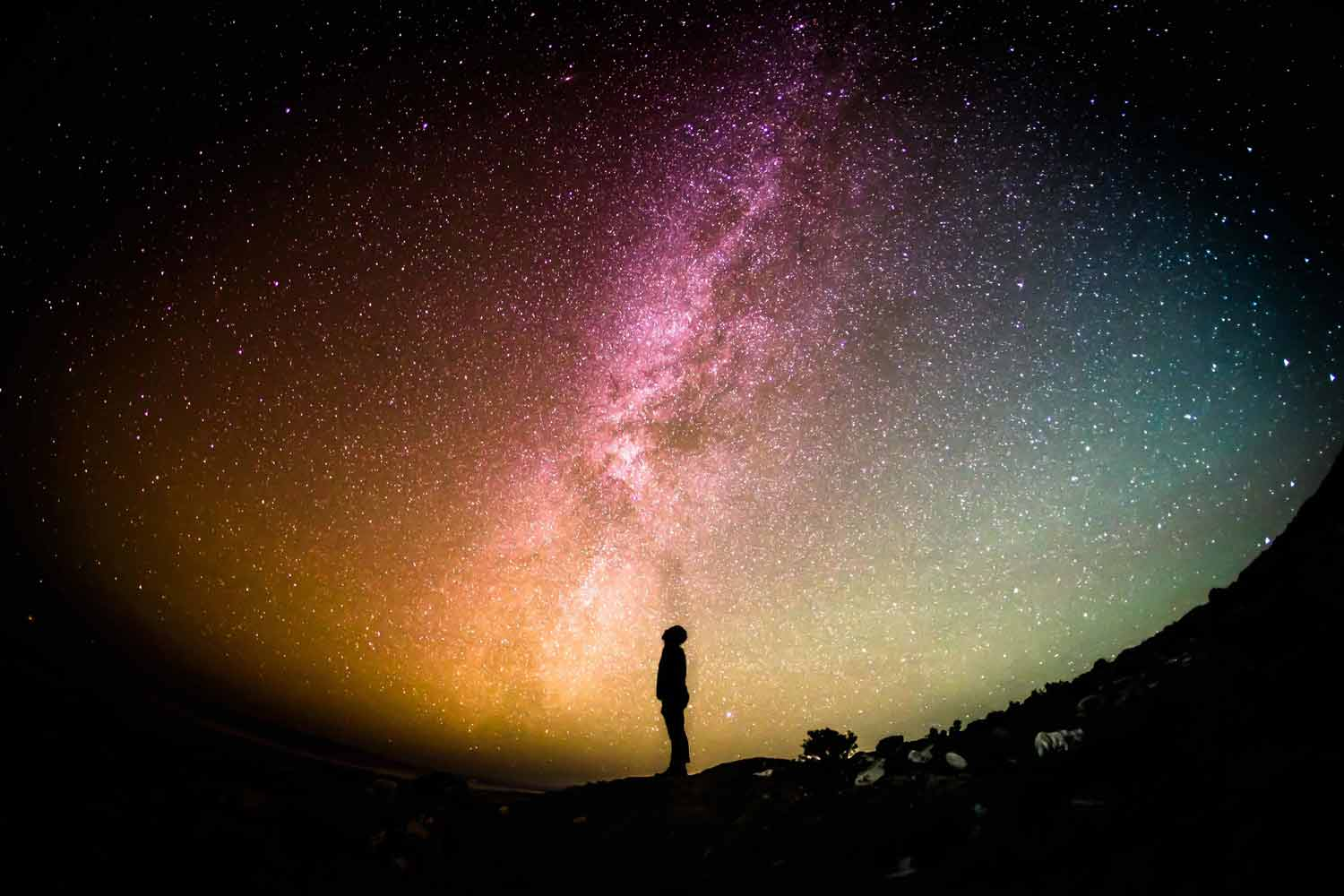 a man looking up into the sky that looks like the universe