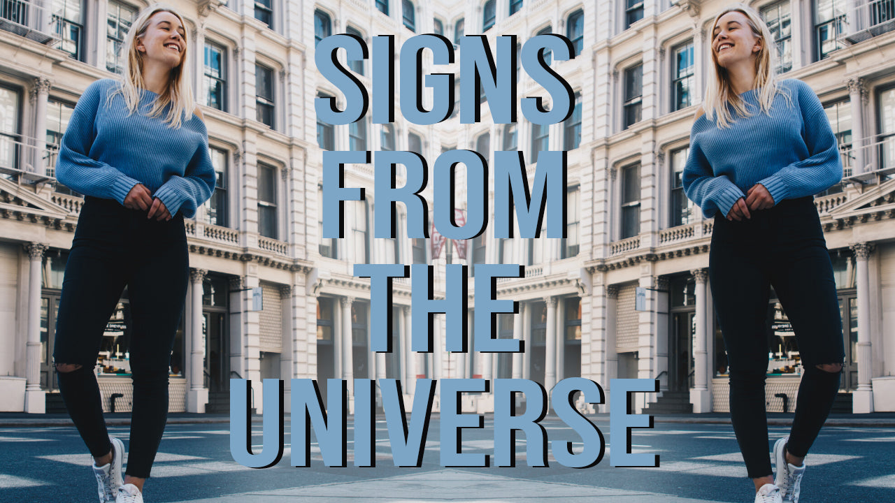 a girl standing posing in new york city asking the universe for a sign