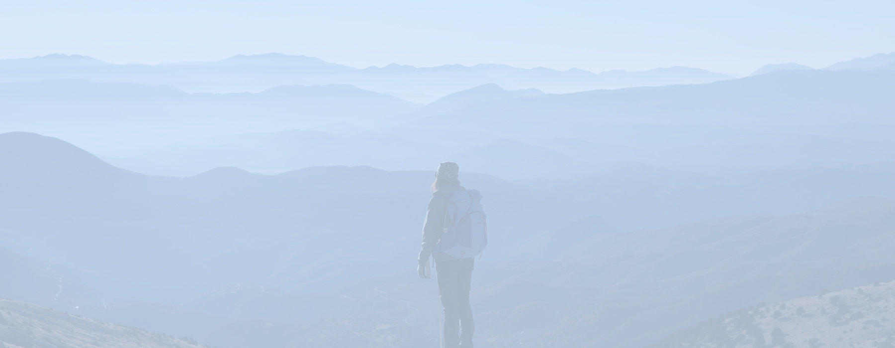a woman standing looking at mountains blog cover for personal growth and spirituality