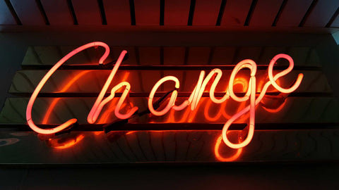 neon sign that says change for an article about life coach near me