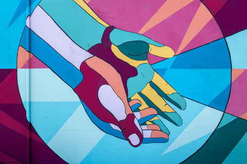 a colorful mural of open hands