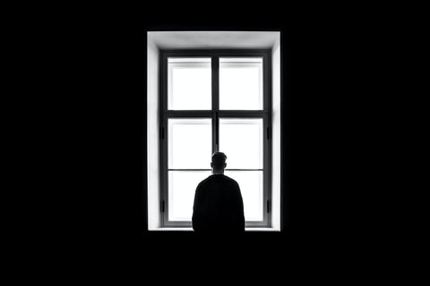 a man looking out of the window