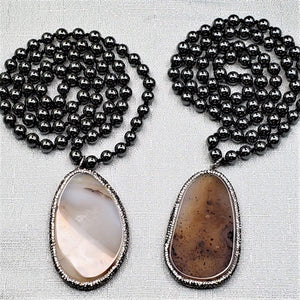 Hematite Necklace with Pave Encrusted Agate Slice Pendant.