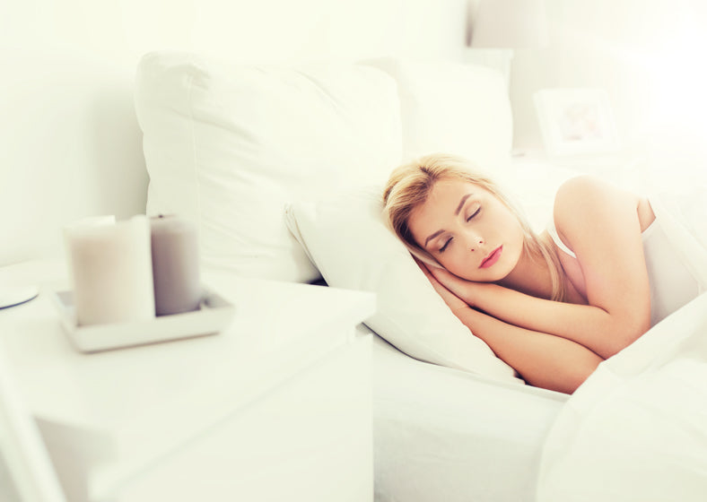 A woman sleeping comfortably using a latex pillow on a summer day