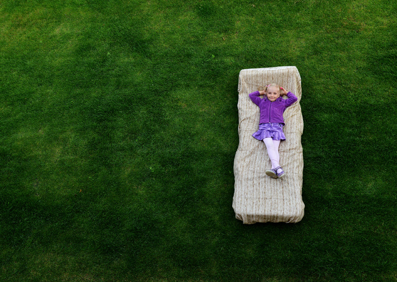Repurpose your old mattress by using it as a cushion for your outdoor day bed