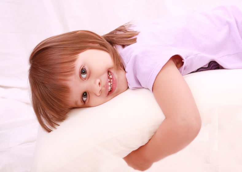 A kid lying on a bed