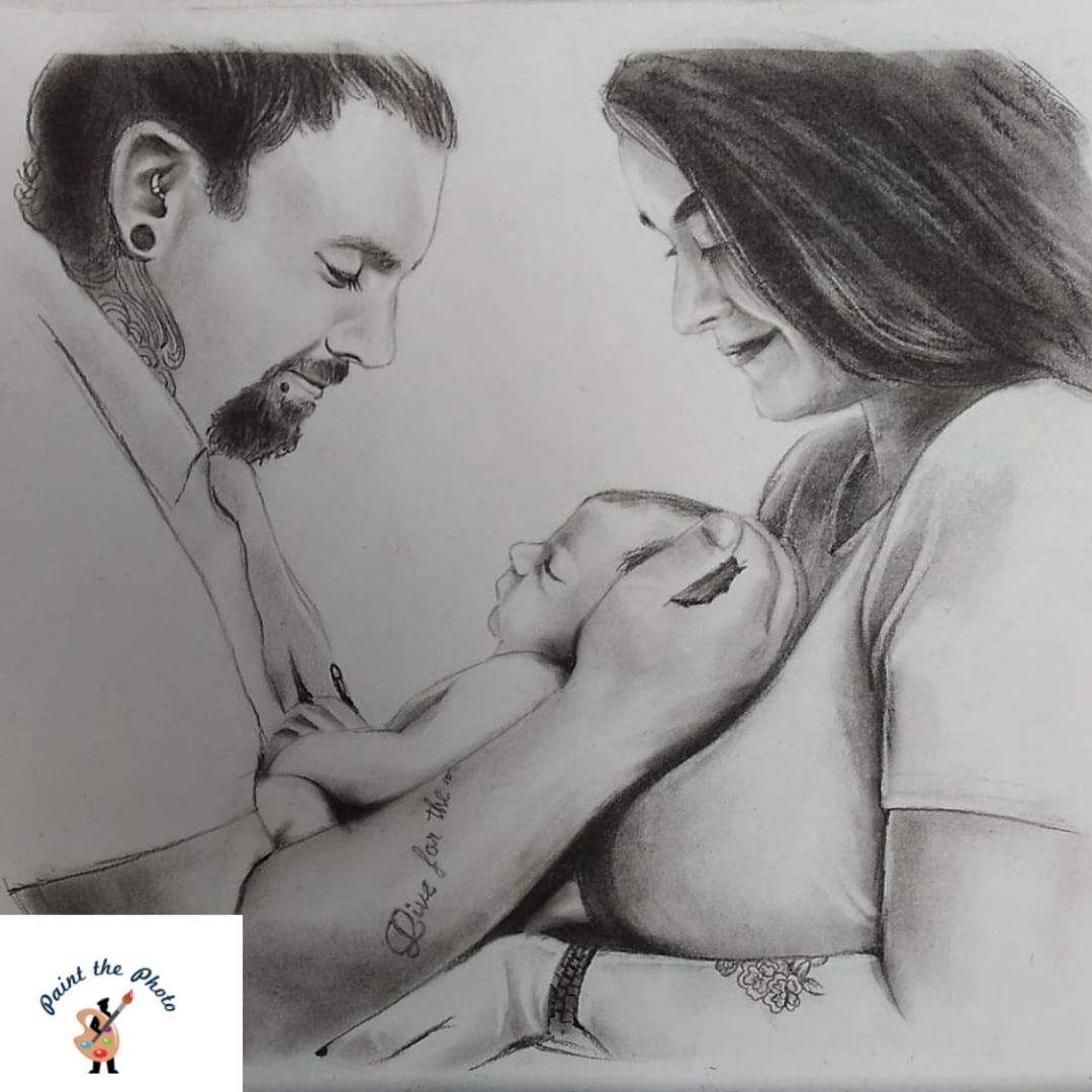 charcoal sketch of couple with baby