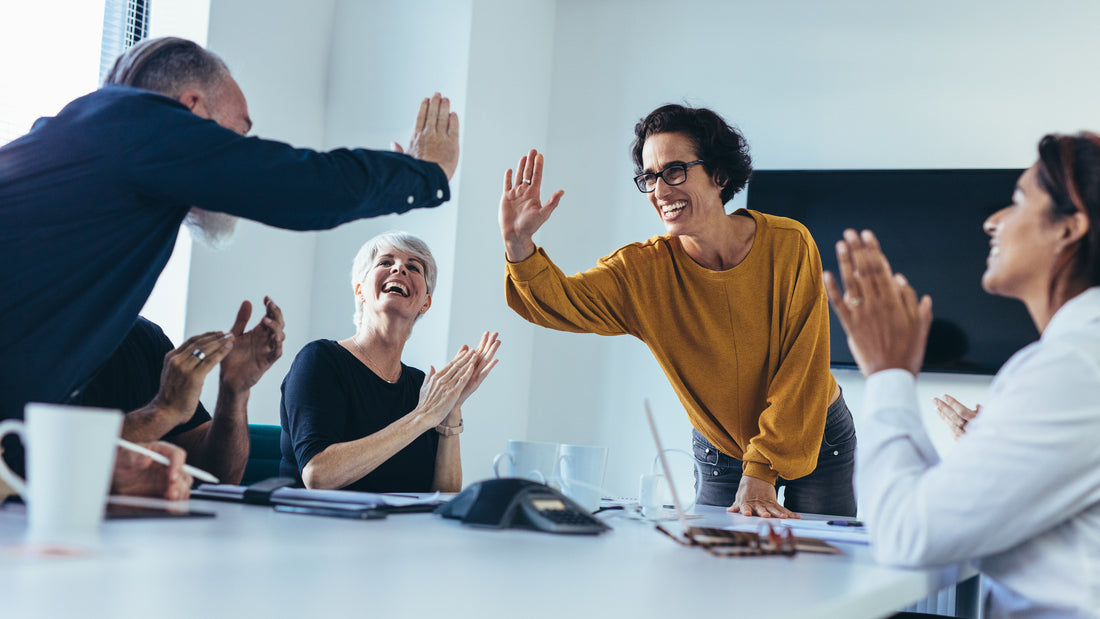 Stock image of excited customers.