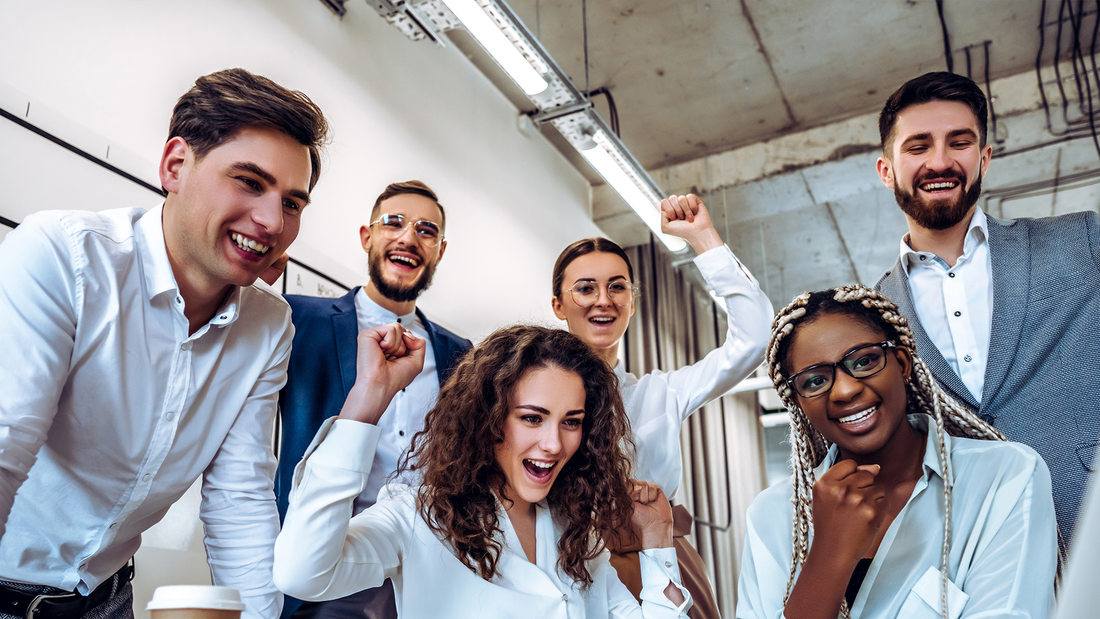 Stock image of excited employees.