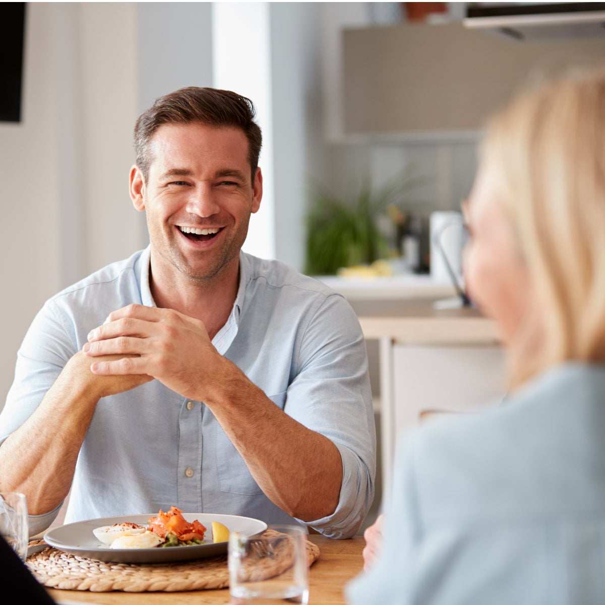 adult man smiling at senior woman