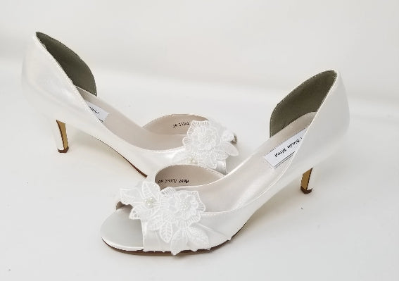 white bridal shoes with lace flower design