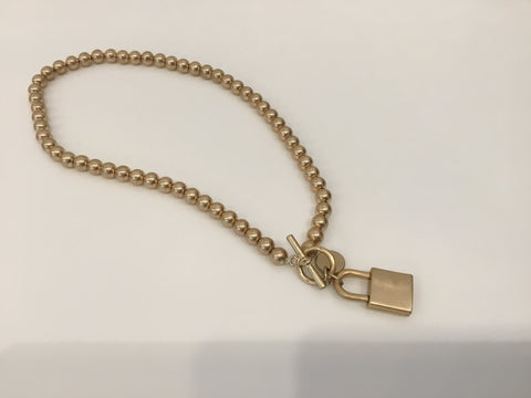 Brushed gold lock necklace
