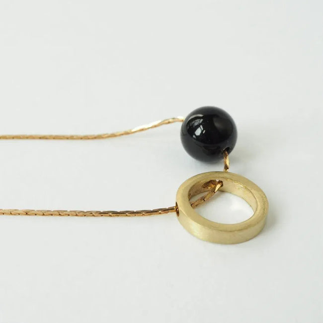 Brass Circle And Onyx Stone Necklace - british-red-cross