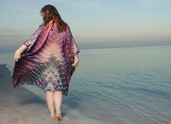 Model wearing a Silk Shibori Kaftan on a beach back view