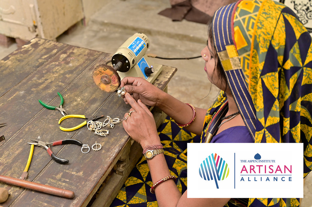 Image of a woman handcrafting jewelry certified by The Artisan Alliance community network