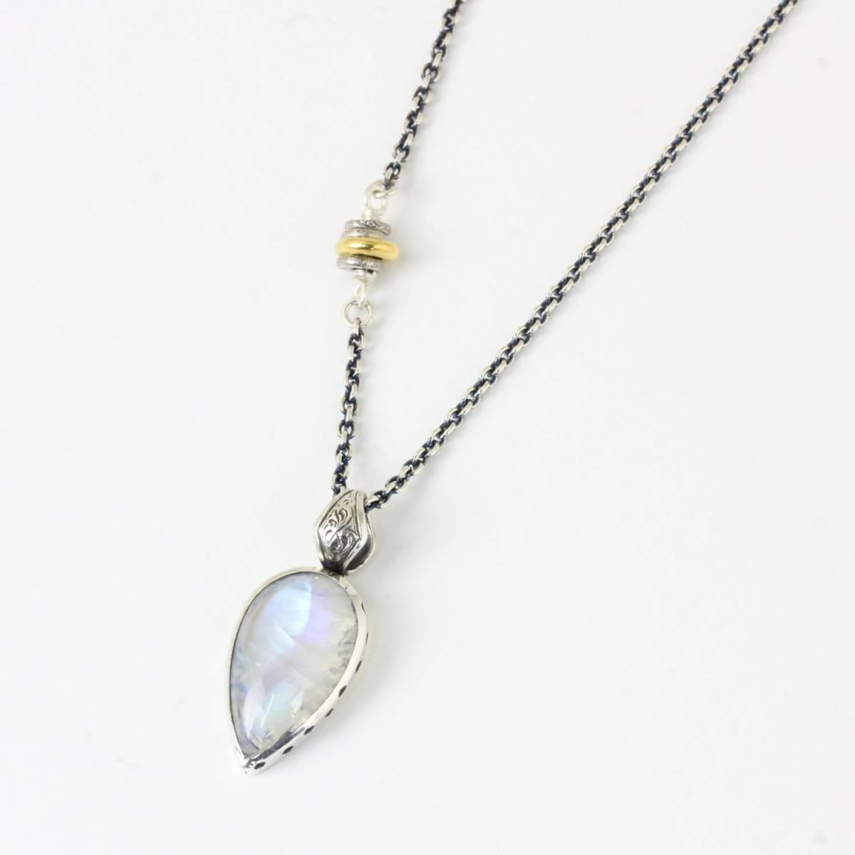 Necklaces Bezel set moonstone gemstone with hand engraved detailing and oxidized silver chain