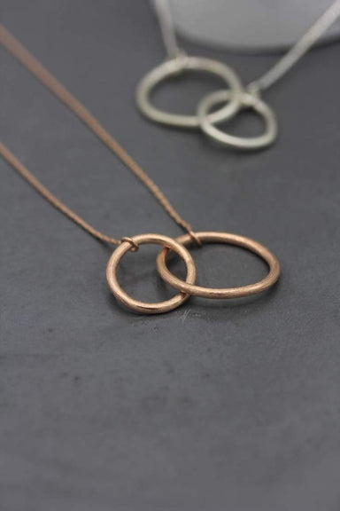 Necklaces Organic interlocked loops infinity pendant necklace coated in rose gold
