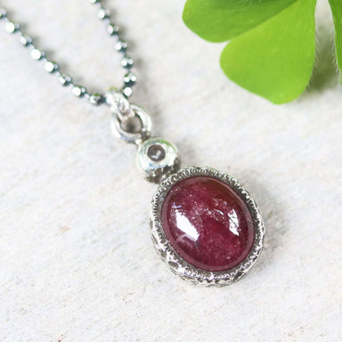 Ruby pendant necklace in silver bezel setting with tiny diamond on the top and oxidized sterling ball style chain - by Metal Studio Jewelry