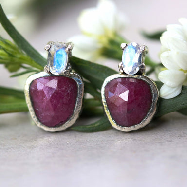 Ruby and tiny oval feacted moonstone stud earrings in silver bezel prongs setting with sterling post backing - by Metal Studio Jewelry