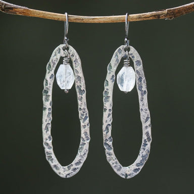 Silver oxidized hammer textured peanut shape hoop earrings with moonstone beads on sterling silver hooks - by Metal Studio Jewelry