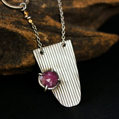 Silver semi oval shape necklace in line design engraving set with round rose cut red ruby silver bezel and prongs setting - by Metal Studio