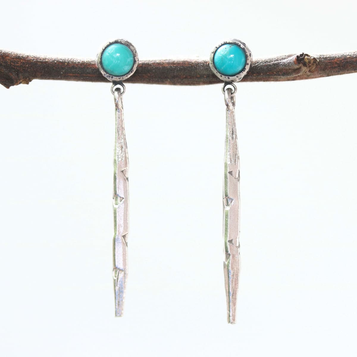 Silver spike earrings with round turquoise in silver bezel setting on sterling stud style - by Metal Studio Jewelry