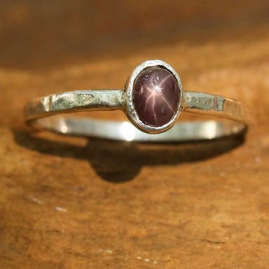 Rings Sterling silver flat texture band ring with oval multi brown star sapphire in bezel setting - Title by Metal Studio Jewelry