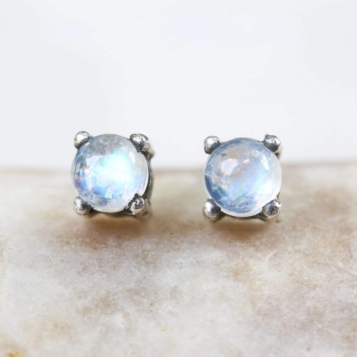 Earrings Sterling silver stud earrings with cabochon moonstone in prongs setting sterling post and backing