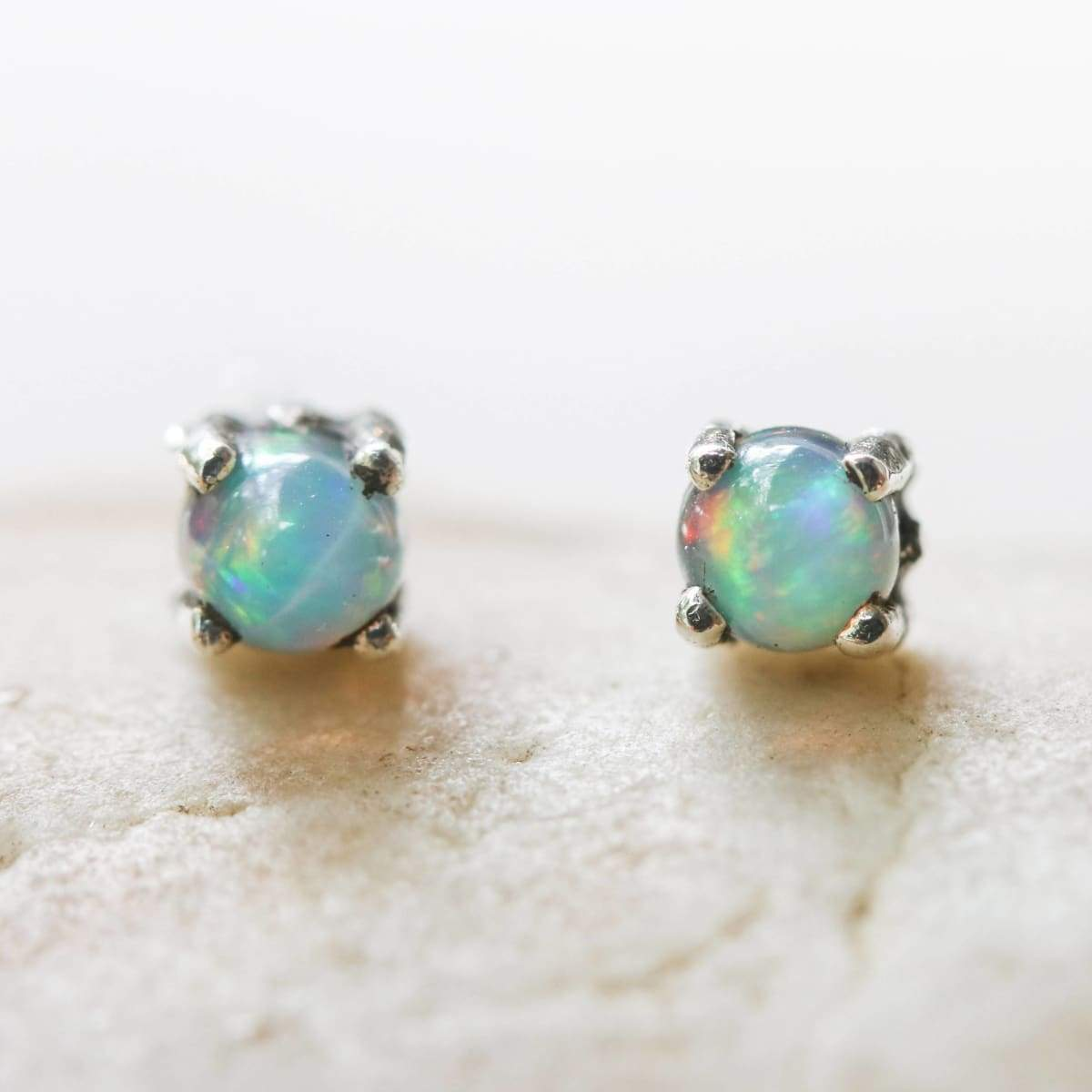 Earrings Sterling silver stud earrings with opal cabochon in prongs setting sterling post and backing
