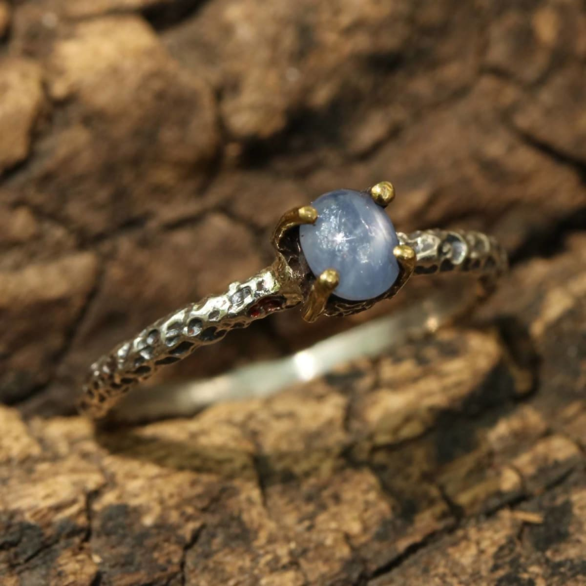 Rings Sterling silver textue ring with blue sapphire in bezel brass prongs setting - Title by Metal Studio Jewelry