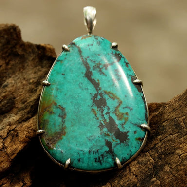 Teardrop Blue turquoise pendant in silver bezel setting with polished accent prongs - by Metal Studio Jewelry