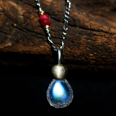 Teardrop moonstone pendant necklace in sterling silver bezel setting with ruby beads on the side - by Metal Studio Jewelry